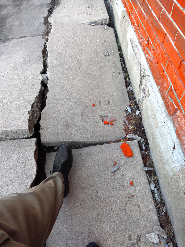 premises liability lawyer broken sidewalk